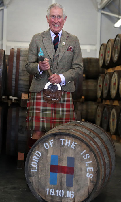 A kilt-wearing Prince Charles sealed a cask while visiting the Isle of Harris Distillery, which he officially opened in Tarbert on the Isle of Harris.  
