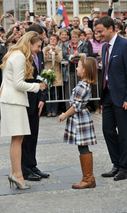 After their civil ceremony, Guillaume walked past a crowd of well-wishers who lined the streets to watch the live broadcast. A young spectator presented the couple with flowers. 