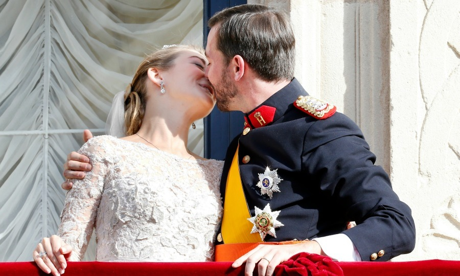 Sealed with a kiss! Guillaume and Stephanie took to the balcony of the Grand Ducal Palace where they shared a smooch as newlyweds in front of the crowd. 