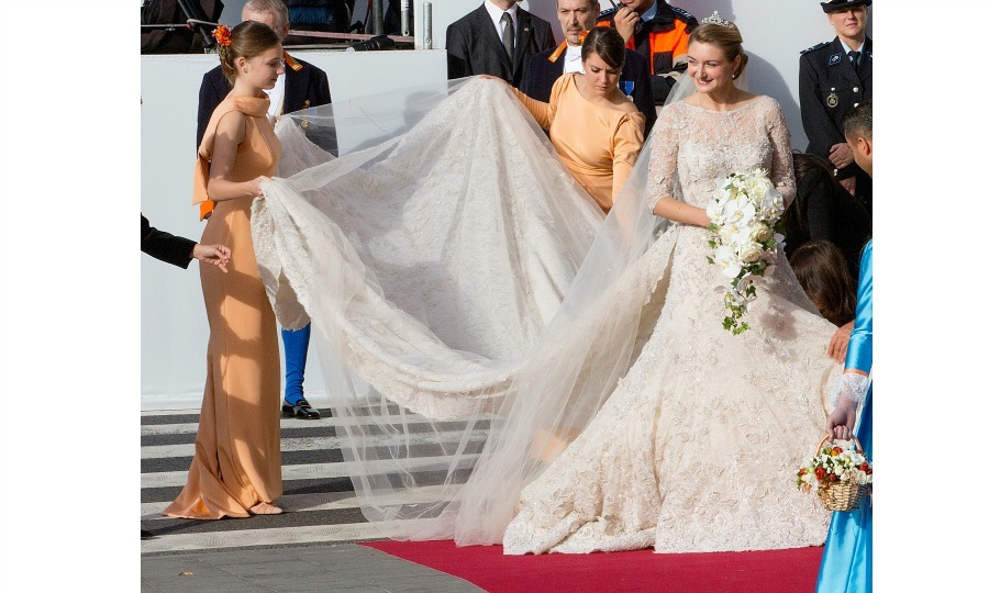 Stephanie's bridesmaids, Princess Alexandra of Luxembourg and Antonia Hamilton, helped her showcase her custom made Elie Saab gown. The bride's gown, which was one of two dresses made by the designer for her big day, featured a 14-foot train, 50,000 pearls and took a grand total of 4,000 hours to make. 