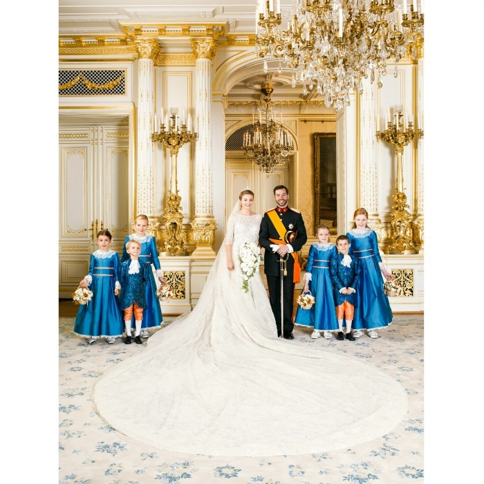 After the religious ceremony, the couple posed for the official wedding photo with their flower girls and page boys. 