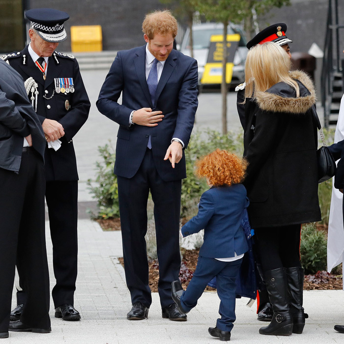 What are those?! Prince Harry checked out the snazzy shoes of a young ginger-haired child at the Metropolitan Police Service annual Ceremony of Remembrance at the Metropolitan Police Training College in London.