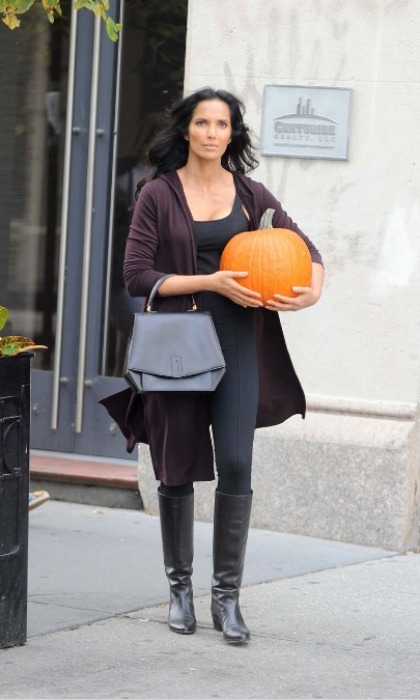 October 18: Padma Lakshmi sported J.Jill's new Tencel collection in New York City while she had both hands full with a pumpkin and her new book <i>The Encyclopedia of Spices & Herbs</i>.