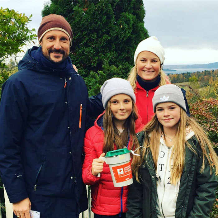Crown Prince Haakon and Crown Princess Mette-Marit of Norway stepped out with their daughter Princess Ingrid Alexandra to raise money for the Norwegian Red Cross.