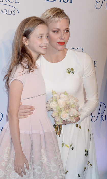 Upon her arrival to New York's Cipriani 25 Broadway, where the Princess Grace Gala was held, the Monaco royal was presented with a bouquet of flowers by Giselle Paulson.