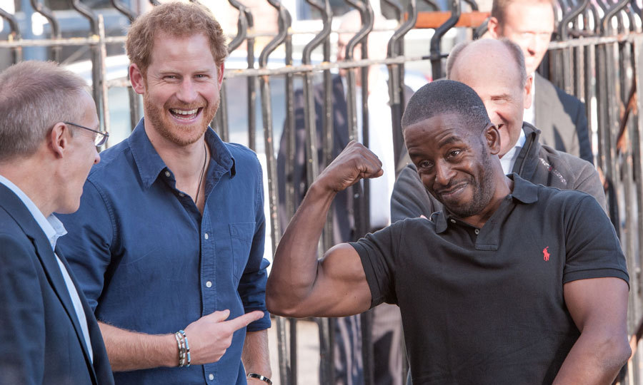 Harry had a front row seat to the <i>gun show</i>. The royal laughed, while pointing out Trevor Rose's muscle, while visiting a recording studio at the Russell Youth Club in the St. Ann's area of Nottingham.
