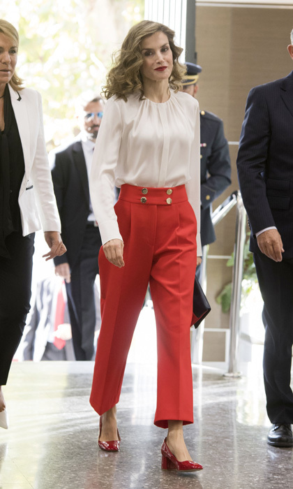 The lady in red - pants! The Spanish monarch opted for a pair of vibrant Uterque button culottes and matching shoes paired with a white BOSS blouse to attend Red Cross fundraising day in October 2016.