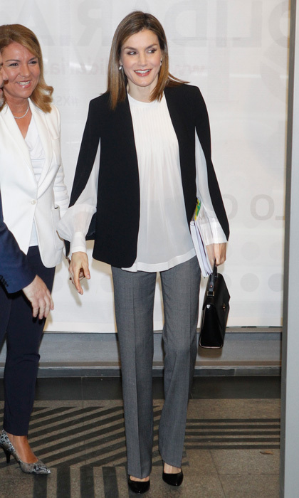 Letizia looked professional in a black, white and grey ensemble. The Queen wore grey trousers by BOSS paired with a black Zara cape to meet with the Spanish Committee of Representatives for People with Disabilities in April 2016.