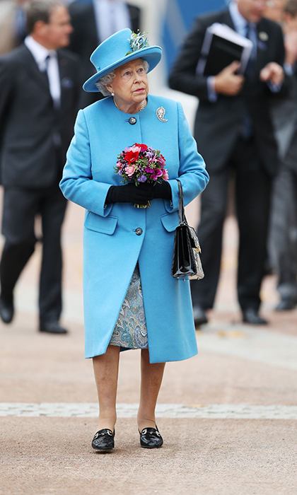 Queen Elizabeth wore a cheerful blue coat and matching hat for her visit to Poundbury.