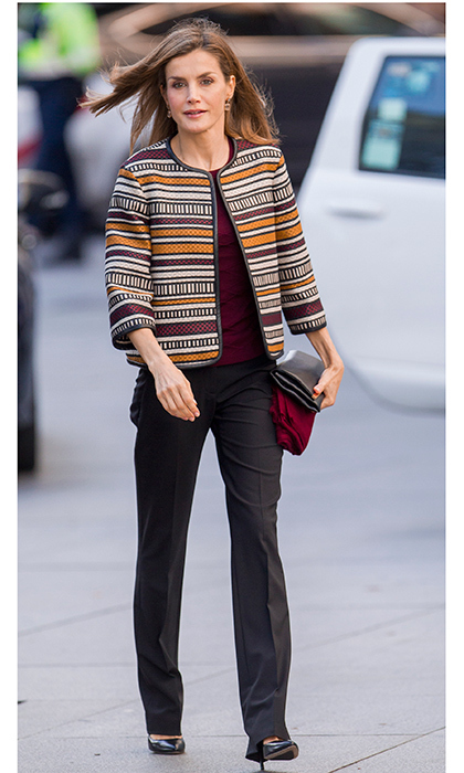 A statement jacket in autumnal burgundy and mustard hues added a lively finishing touch to Queen Letizia's look.