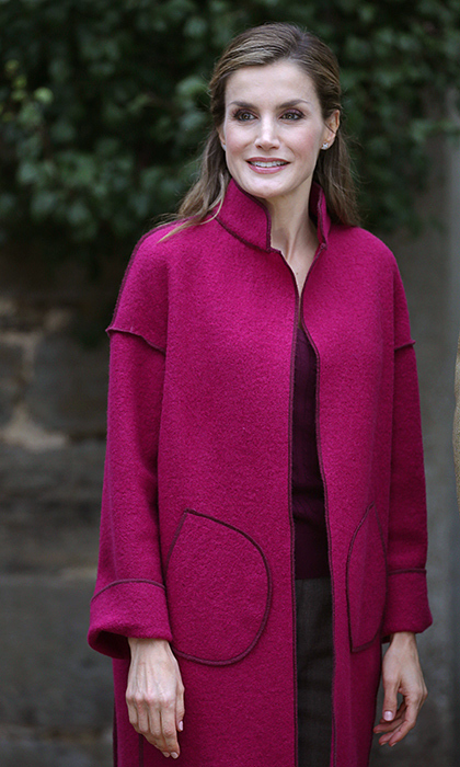 Spain's Queen Letizia monarch made an eye-catching appearance in this fuchsia coat.