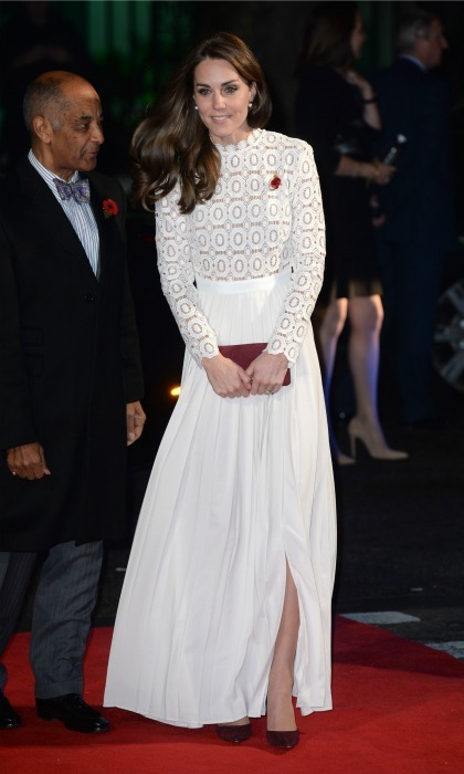 Kate stunned at the premiere of <i>A Street Cat Named Bob</i> donning a winter white dress by Self-Portrait, which featured a pleated skirt and long-sleeves. The Duchess completed her look wearing her glossy tresses down in loose waves.