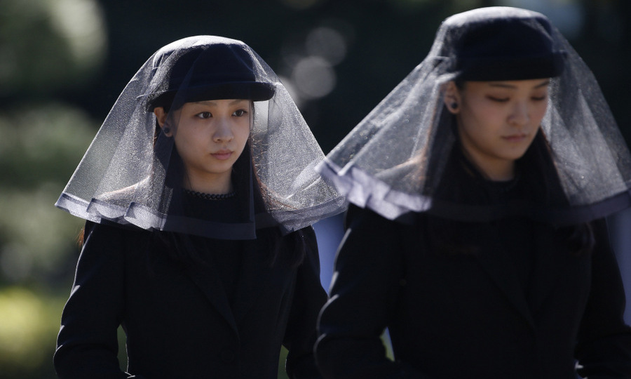 Emperor Akihito's eldest grandchild, 25-year-old Princess Mako, right, and her sister Princess Kako, 21, attended Prince Mikasa's funeral at the Toshimagaoka cemetery in Tokyo.
