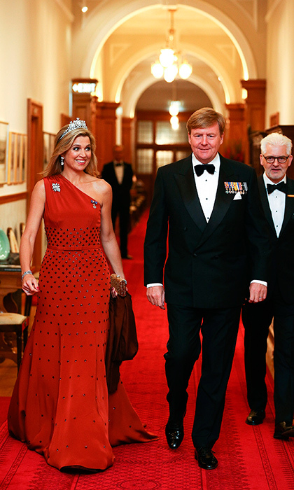 On November 7, Queen Maxima looked stunning in a red Claes Iversen dress for the state dinner at Government House in Wellington, New Zealand.