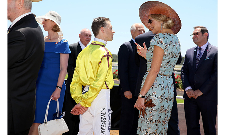 For Melbourne Cup Day at Ascot Racecourse in Perth, Queen Maxima took our eyes off the track by wearing a geometric baby blue Natan Couture dress. Here, she chats with jockey Steven Parnham. 