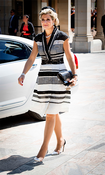 Queen Maxima wore a black and white Claes Iversen wrap dress with a black silk hat for a sunny day out in Brisbane.