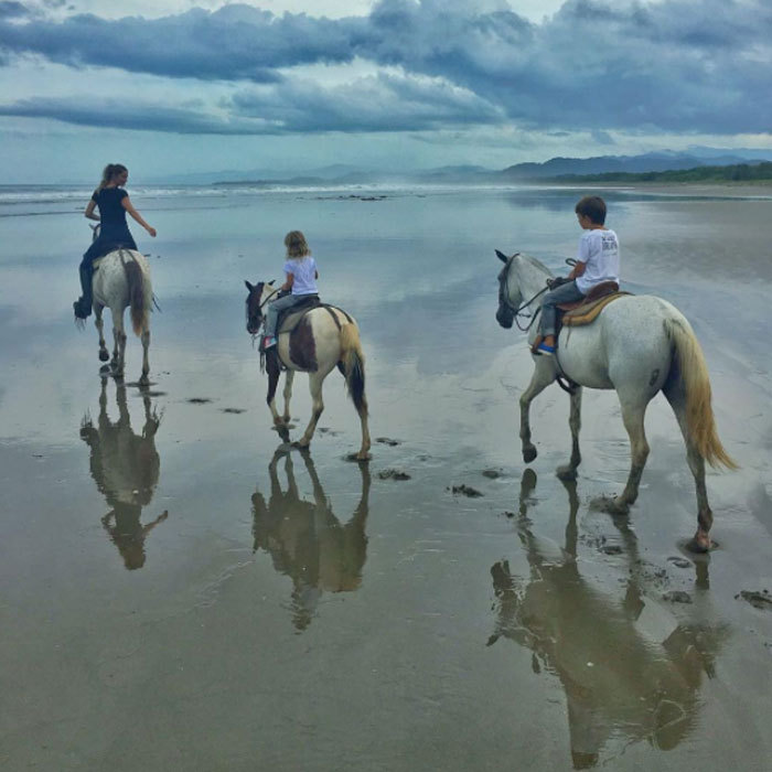 "Gisele Bündchen saddled up for horseback riding on the beach with her family. The supermodel led the way in a scenic photo posted to Instagram, which she captioned, ""It's not about the destination, it's about the journey #gratitude #family #nature.""