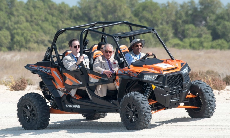 Riding dirty! Prince Charles threw on his shades and took a ride on a four wheeler during a visit to Bu Tinah Island. 