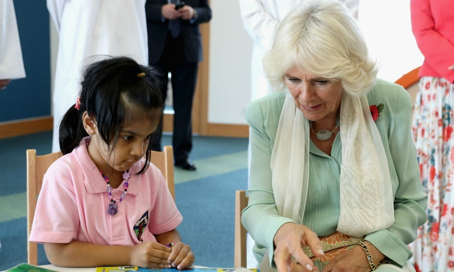 Prince Charles' wife completed a puzzle with a young girl during her visit to Oman's first children's public library in Muscat. 