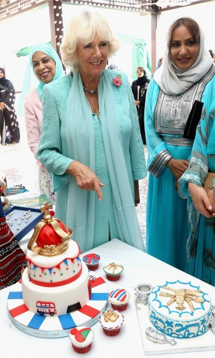"Let them eat cake! Camilla paid a visit to the Etab Al-Zadjali's cake business stand during the ""Woman in Business"" event held at the British Ambassador's Residence in Muscat, Oman. 