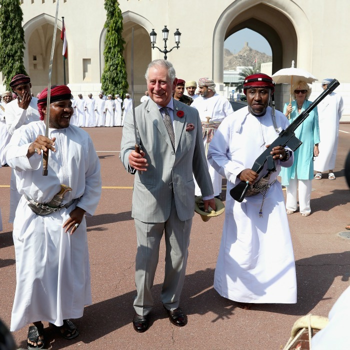 Prince Charles took part in a traditional Omani sword dance during a cultural welcome ceremony outside the Sultan's Palace in Muscat, Oman.