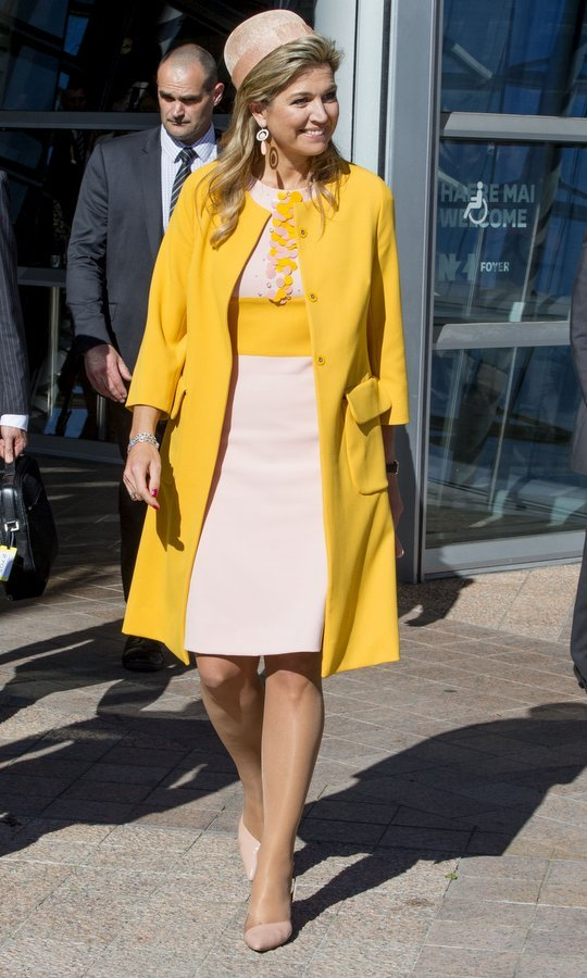 Queen Maxima wore vibrant yellow and pastel pink for a meeting with the Dutch community in Christchurch, New Zealand on November 8.