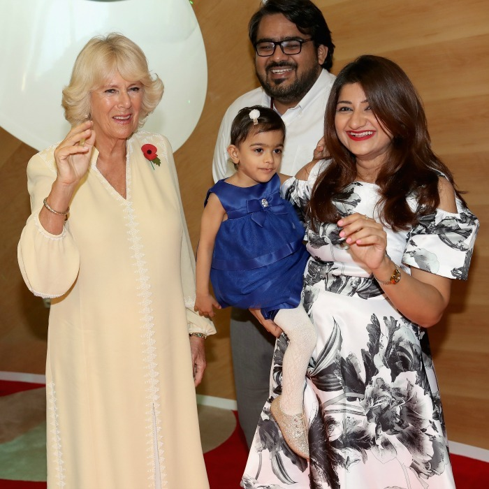 Camilla smiled with a young patient and her parents during her visit to Al Jalila Children's Speciality Hospital. 
