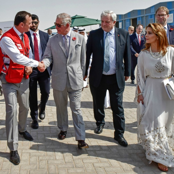 Charles shook hands with onlookers as he toured the Humanitarian International City with Princess Haya bint al-Hussein. 