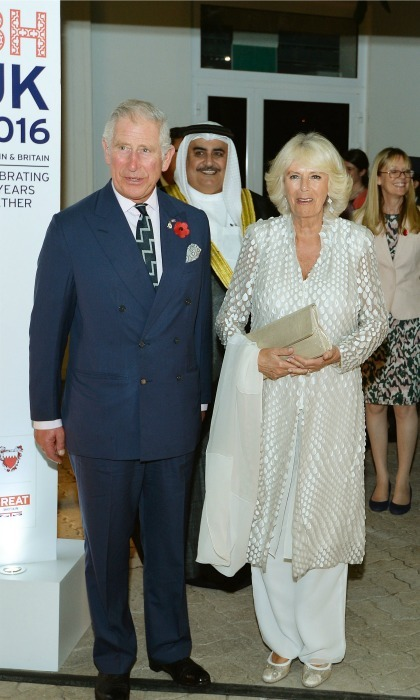 Charles and Camilla got all dressed up to attend the 200th anniversary receptoin of bilateral relationships between the UK and Bahrain at the British Ambassador's residence in Manama, Bahrain. 