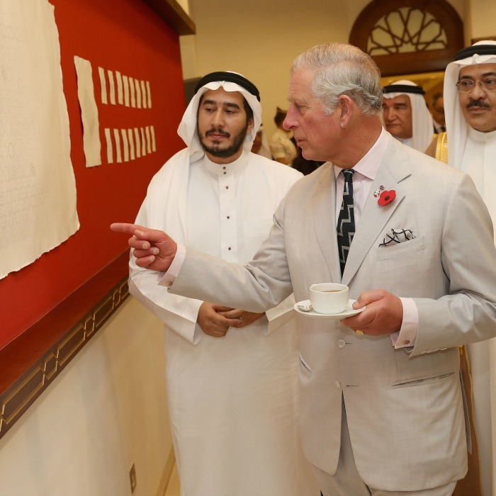 The Prince of Wales looked at art work while he toured the Bahrain Cultural Centre in Manama. 
