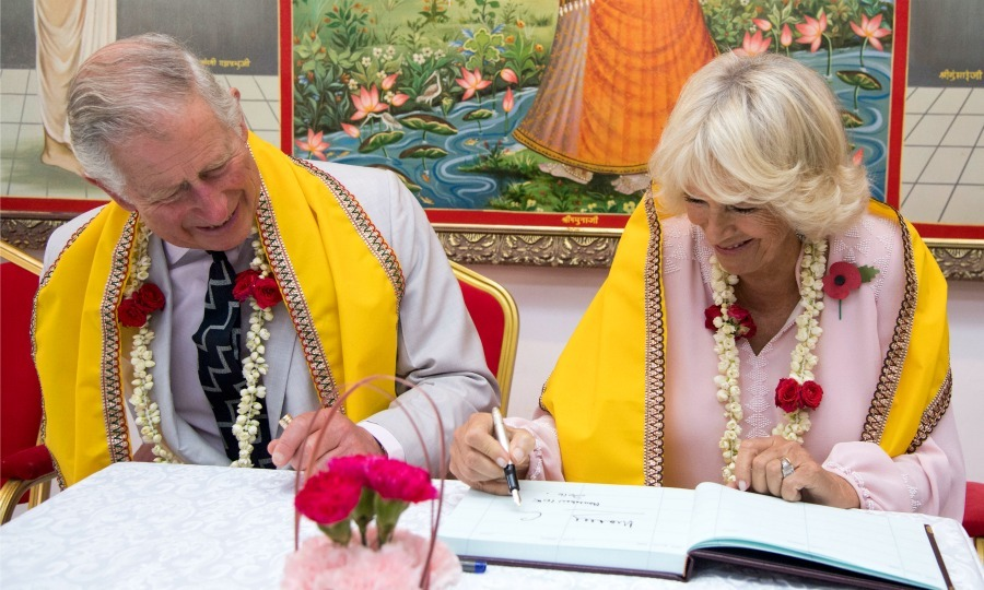 Upon their arrival to the Krishna Temple, Charles and Camilla wore yellow scarves and garland as they left their mark at the 200 year old temple in the capital of Bahrain. 