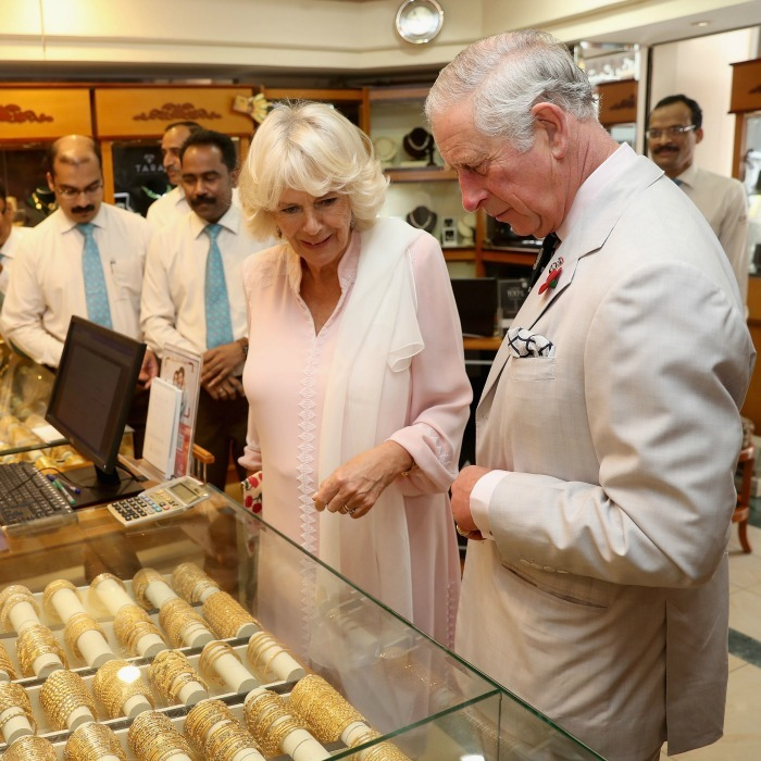 Golden opportunity! Camila and Charles eyed gold in a shop during their tour of a local Souk in Manama, Bahrain. 
