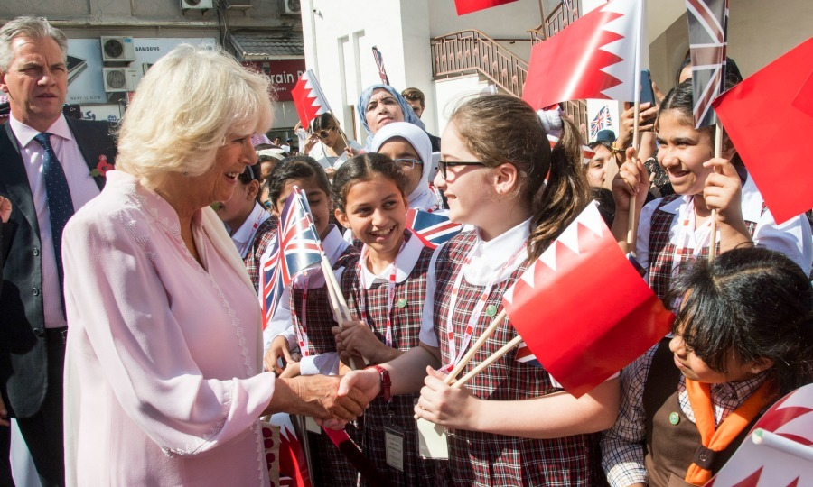 Camilla shook the hand of a young girl outside of the Old Post Office Museum in Manama, Bahrain. Camilla and her husband were briefed on the history of Bahrain's postal service and unveiled two new stamps designed to commemorate the 200th anniversary of the UK – Bahrain relationship. 