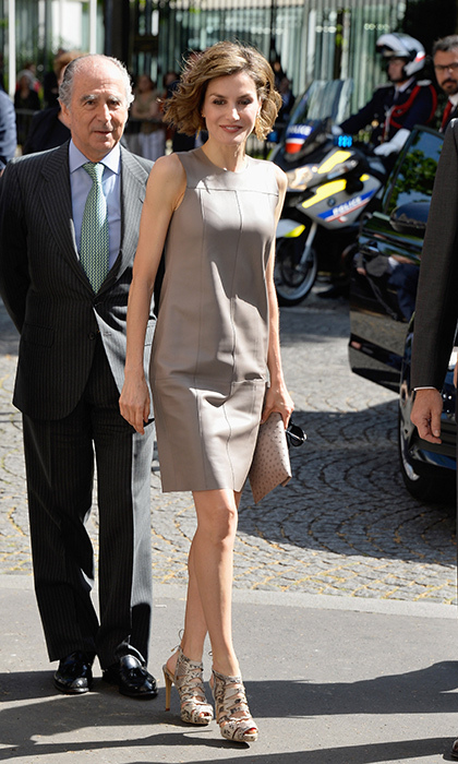 The royal opted for a grey leather lambskin BOSS dress for a day out in Paris.