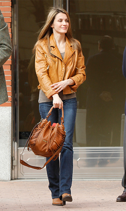 Queen Letizia achieved the ultimate street style look with her brown leather bag and biker jacket combo.