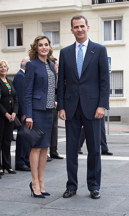 King Felipe VI and wife Queen Letizia were perfectly matched for their their visit to the Bosch exhibition at the Prado Museum. The Spanish Queen looked sharp in a blue croc leather-look ensemble from BOSS.