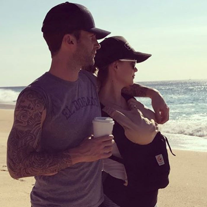 "Adam Levine is basking in fatherhood. The singer and his wife Behati Prinsloo stepped out to the beach with their newborn daughter Dusty Rose. Sharing a photo from the family outing, Adam wrote, ""Everything I need is right here. (Beach optional).""