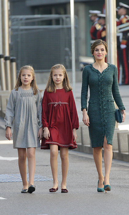 Queen Letizia and her two girls Infanta Sofia, nine, left, and 11-year-old Princess Leonor, were the ultimate in mother-daughter chic with their braided hairstyles and long-sleeved dresses.