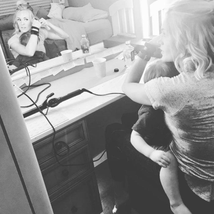 "The fact that she had to get ready for a show couldn't stop Carrie Underwood from cuddling with her son. The country star shared a photo of herself doing her hair as Isaiah sweetly rested on her lap. Attached to pic, Carrie wrote, ""He doesn't care that Mommy had to get ready for a show... all he knows is that he woke up cranky from his nap and needed a cuddle... and I was more than happy to comply. #multitasking #momlife #roadlife #thestorytellertour.""