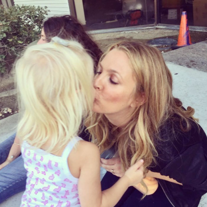 "Drew Barrymore stole a kiss from her youngest daughter Frankie. Attached to the photo, the actress wrote, ""#peopleilove Frankie Barrymore Kopelman. This moment makes the whole world fall away for me.""