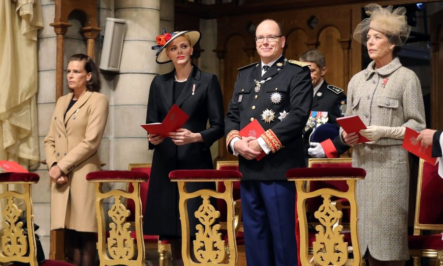 During the mass held at Saint Nicholas cathedral, Princess Charlene, second from left, joined husband Prince Albert and Princess Grace's two daughters,  Princess Stephanie, left, and Princess Caroline.