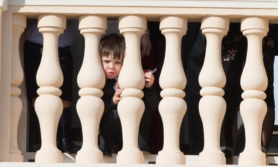 Peek-a-boo! Raphaël took in the sights from his very special vantage point. 