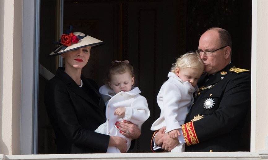 Greeting wellwishers from the Palace balcony, Princess Charlene held daughter Princess Gabriella while Prince Albert placed a kiss on the head of his heir, son Prince Jacques.