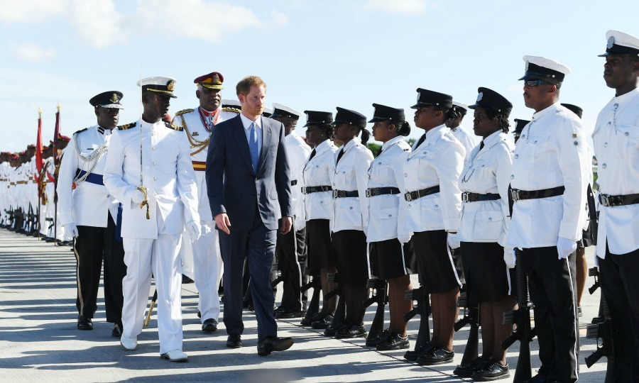 Harry inspected the guard of honor upon touching down at V.C. International Airport in Antigua. 
