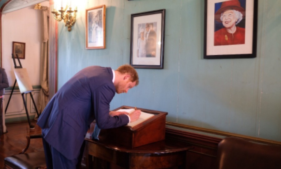 Prince Harry had a very special set of eyes on him as he signed the guest book at the Government House of Antigua. 