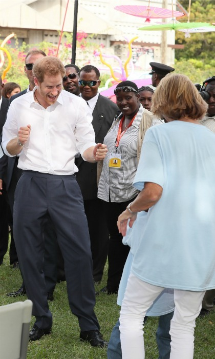 Show me your moves! Harry met with children from various charities during his visit to the Government House of Antigua. 