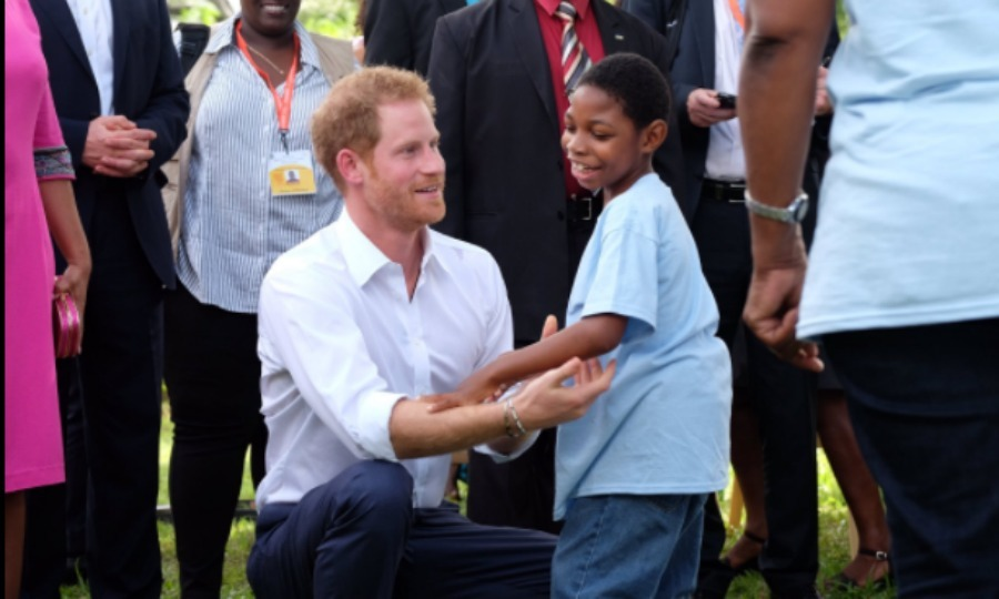 Harry got a warm welcome from a child while he attended a Charities Showcase at the Government House of Antigua. 