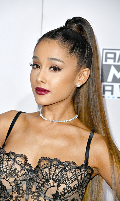 Ariana Grande rocked her signature sleek pony and on-trend berry lips at the American Music Awards in L.A. on November 20.