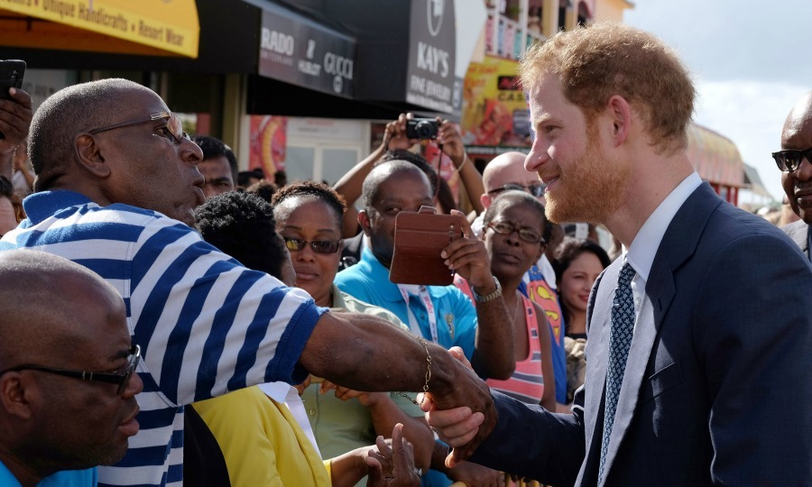 Harry touched down on the island of St. Kitts. The Prince was greeted with sunshine, performances and a long line of people waiting to shake his hand. 