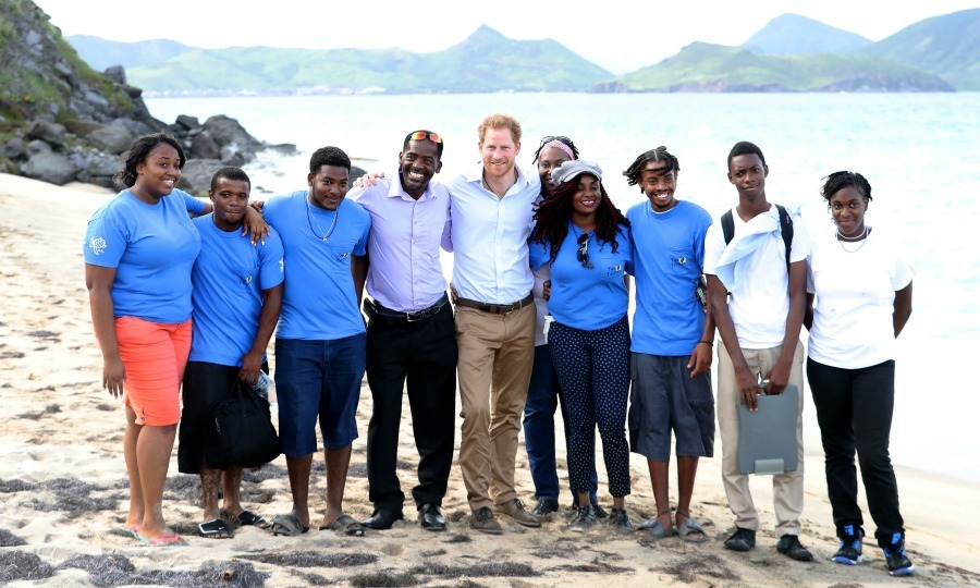 Harry posed with the founder of the Nevis Turtle Group, Lemuel Pemberton and volunteers on Lover's Beach. 